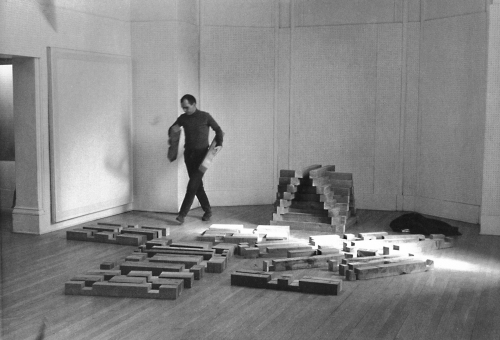 Carl Andre building 'Cedar Piece', 1964